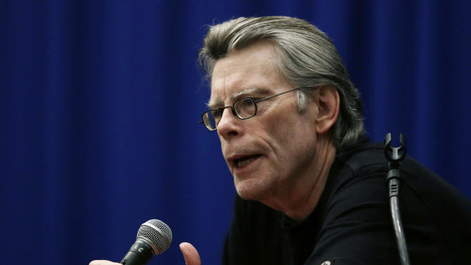 Novelist Stephen King speaks to creative writing students at the University of Massachusetts-Lowell in Lowell, Mass., Friday, Dec. 7, 2012. (AP Photo/Elise Amendola)