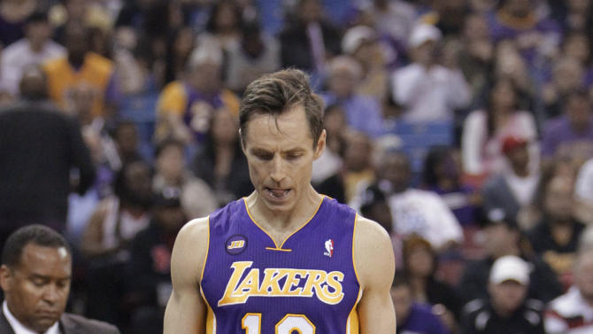 Los Angeles Lakers guard Steve Nash walks to the locker room after injuring his hamstring during the first quarter of an NBA basketball game against the Sacramento Kings in Sacramento, Calif., Saturday, March 30, 2013. (AP Photo/Rich Pedroncelli)
