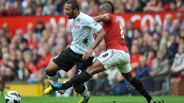 Fulham's Moussa Dembele (left) and Manchester United's Oliveira Anderson (right) battle for the ball (PA Sport)