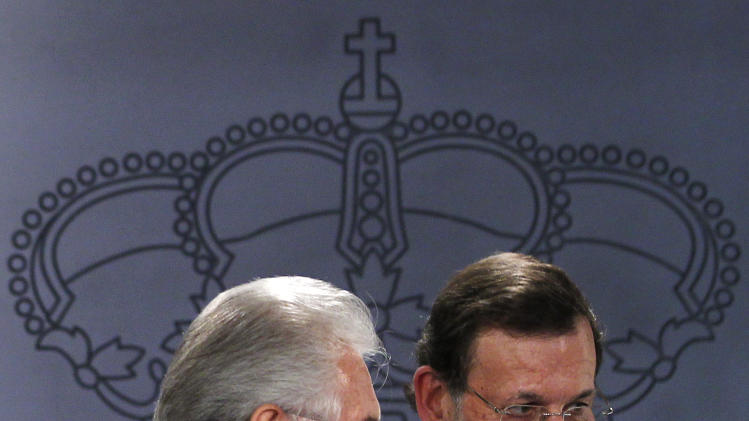 Spain's Prime Minister Mariano Rajoy, right, and Italy's Prime Minister Mario Monti, left, leave after a press conference at the Moncloa Palace in Madrid, Spain, Thursday, Aug. 2, 2012. (AP Photo/Andres Kudacki)