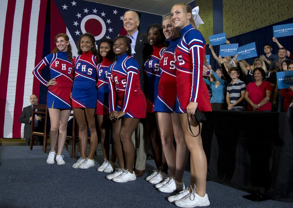 Vice President Joe Biden poses for a photo with the Portsmouth High School Cheerleaders during a campaign event at Portsmouth High School, Sunday, Sept. 9, 2012, in Portsmouth, Ohio.  (AP Photo/Carolyn Kaster)