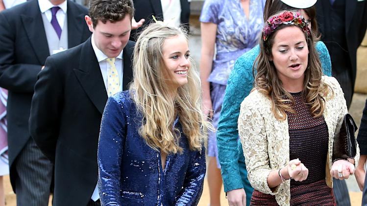 Cressidea Bonas, left, the girlfriend of Britain's Prince Harry, leaves after attending the wedding of the Duke and Duchess of Northumberland's daughter Lady Melissa Percy to chartered surveyor Thomas van Straubenzee at St Michael's Church in Alnwick, England, Saturday, June 22, 2013. (AP Photo/Scott Heppell)