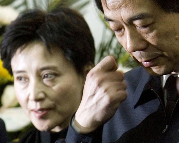 FILE - In this Jan. 17, 2007 file photo, Gu Kailai, left, wife of then Chinaese Commerce Minister Bo Xilai, right, attends a memorial ceremony for Bo's father Bo Yibo, a late revolutionary leader considered one of communist China's founding fathers, at a military hospital in Beijing. Gu who is accused of murdering Bo family associate Neil Heywood went on trial Thursday, Aug. 9, 2012 at the Hefei Intermediate People's Court in eastern China. Gu and family aide, Zhang Xiaojun, are alleged to have poisoned Heywood together. (AP Photo/Alexander F. Yuan, File) (AP Photo/Alexander F. Yuan, File)