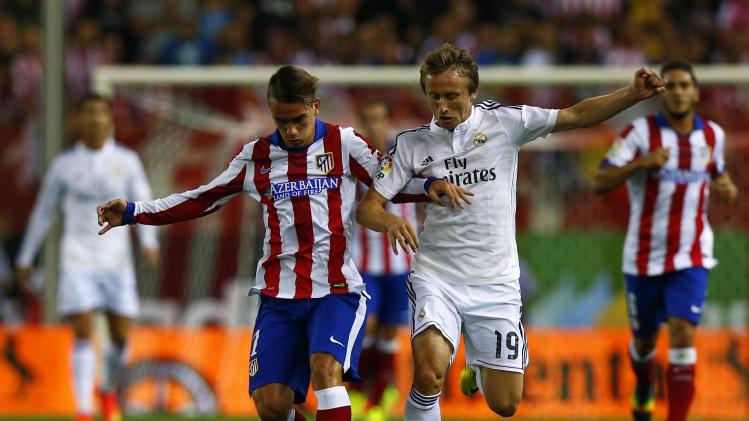 Atletico Madrid's Griezmann and Real Madrid's Modric fight for the ball during their Spanish Super Cup second leg soccer match in Madrid