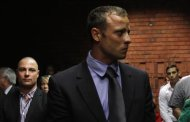 &quot;Blade Runner&quot; Oscar Pistorius awaits the start of court proceedings in the Pretoria Magistrates court, February 19, 2013. Pistorius, a double amputee who became one of the biggest names in world athletics, was applying for bail aftr being charged in court with shooting dead his girlfriend, 30-year-old model Reeva Steenkamp, in his Pretoria house. REUTERS/Siphiwe Sibeko