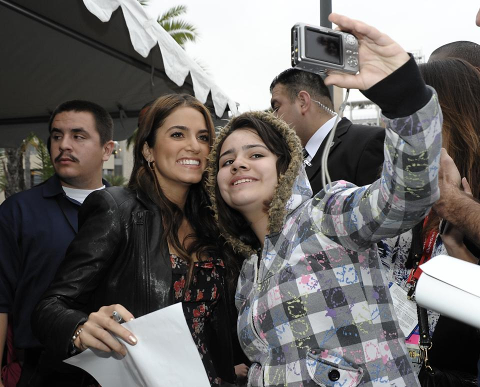 "Actress Nikki Reed surprises fans by making an early morning appearance at Comic Con in San Diego, Calif. on Thursday, July 21, 2011. Cast members of ""The Twilight Saga: Breaking Dawn - Part 1"" signed autographs and met fans waiting in line to enter the San Diego Convention Center.(AP Photo/Dan Steinberg)"