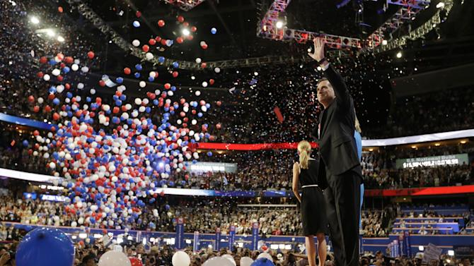 Republican presidential nominee Mitt Romney waves to delegates after his speech at the Republican National Convention in Tampa, Fla., on Thursday, Aug. 30, 2012, as the balloons fall.  (AP Photo/David Goldman)