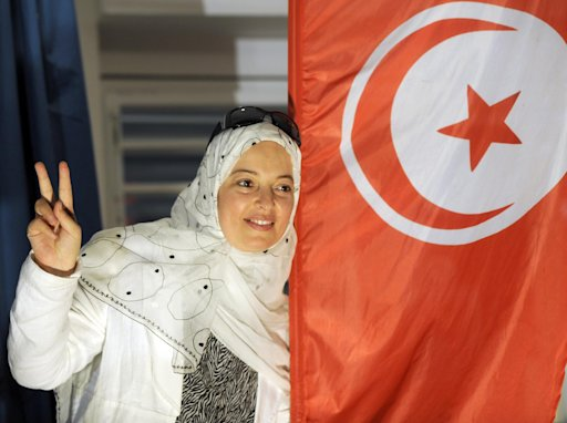 A supporter of Tunisia's Islamist Ennahda party celebrates at the movement headquarters in Tunis