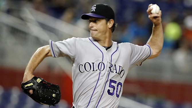 Colorado Rockies starting pitcher Jamie Moyer throws in the first inning during a baseball game against the Miami Marlins in Miami, Monday, May 21, 2012. (AP Photo/Lynne Sladky)