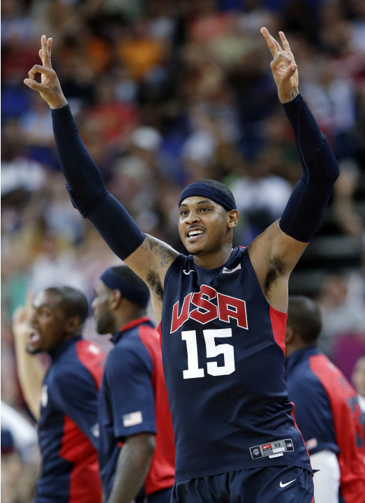 FILE - United States' Carmelo Anthony celebrates after hitting a three-point shot during a semifinal men's basketball game against Argentina at the 2012 Summer Olympics, Friday, Aug. 10, 2012, in Lond