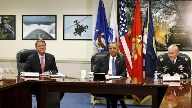 Obama sits down to a meeting with Carter and Dempsey at the Pentagon in Arlington, Virginia