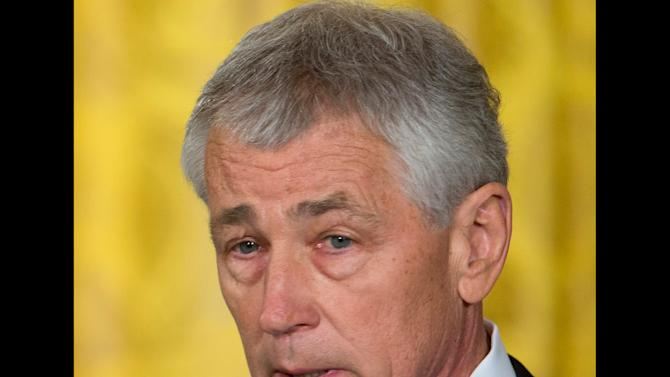 Defense nominee Hagel plans to shed some holdings