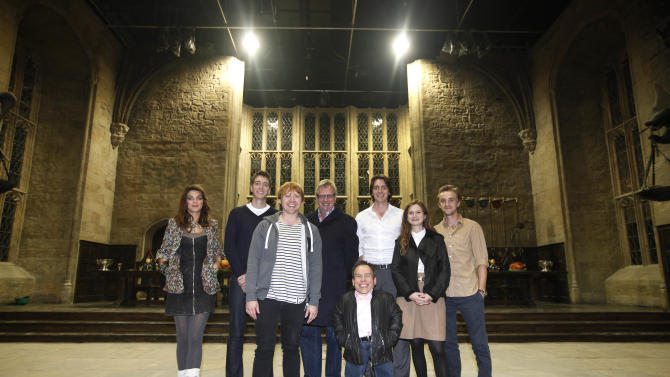 "Actors from the Harry Potter movie series, from left, Natalia Tena, Oliver Phelps, Rupert Grint, Mark Williams, Warwick Davis, James Phelps, Bonnie Wright, and Tom Felton, poses for photographs at the 'Great Hall' one of the sets of the movies during a tour in Watford, north of London, Wednesday Oct. 12, 2011. This collection of sheds and soundstages, a former aerodrome near London is where the eight films were shot over almost a decade, and soon they will be home to the official ""Making of Harry Potter"" studio tour. With more than five months to go until the site's March 31, 2012 opening, tickets go on sale Thursday Oct. 13, 2011. The eight Potter films made here between 2001 and 2010 were a mini-industry, employing both the cream of Britain's acting talent and hundreds of craftspeople and technicians. The tour will show off the skill and craftsmanship that went into the spectacle. (AP Photo/Lefteris Pitarakis)"