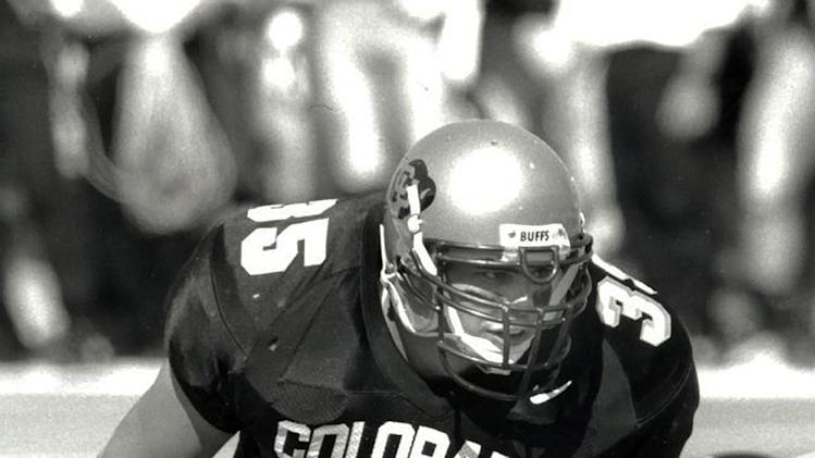 "In this undated photo provided by the University of Colorado, Keith Miller waits for the ball snap as a fullback for the school's NCAA college football team. Miller has reinvented himself, going from the gridiron to the stage and will appear in Verdi's ""Un Ballo in Maschera,"" at the Metropolitan Opera in New York. Performances begin Thursday, Nov. 8, 2012. (AP Photo/University of Colorado)"