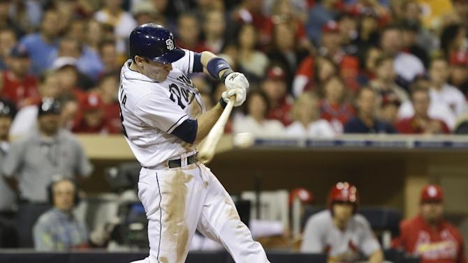 San Diego Padres' Chris Denorfia connects for a solid single to center that drives in Carlos Quentin with the tying run against the St. Louis Cardinals in the sixth inning of a baseball game in San Diego, Monday, May 20, 2013. (AP Photo/Lenny Ignelzi)