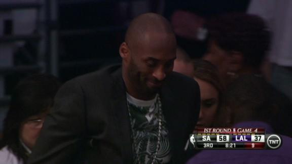 Bryant Sits Behind the Bench