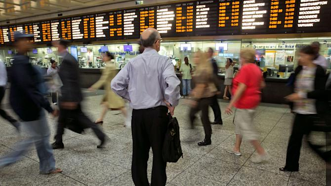 A man consults the LIRR departure board amid morning commuters, in New York's Penn Station, Tuesday, July 15, 2014. Pessimism grew about the prospects of a strike at the nation's largest commuter railroad this weekend after union negotiators said Monday that talks had collapsed amid a dispute over whether future Long Island Rail Road employees should be required to contribute to their health insurance and pensions. A walkout, which the unions said they were planning at 12:01 a.m. next Sunday, would affect 300,000 daily riders who travel in and out of New York City from Long Island.(AP Photo/Richard Drew)