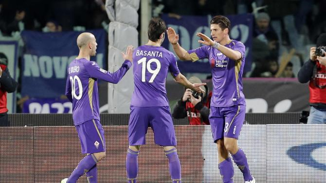 Fiorentina's Mario Gomez (R) celebrates with Borja Valero and Jose Basanta after scoring against AS Roma during their Serie A soccer match in Florence