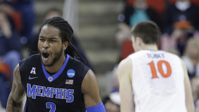 Memphis forward Shaq Goodwin (2) celebrates a basket against Virginia during the first half of an NCAA college basketball third-round tournament game, Sunday, March 23, 2014, in Raleigh. (AP Photo/Gerry Broome)
