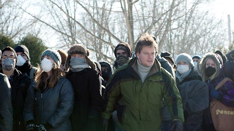 "FILE - This image released by Warner Bros. Pictures shows Matt Damon in a scene from the film ""Contagion."" The Hollywood thriller that opened on Sept. 9, 2011, rocketed to No. 1 at the box office through its gripping tale of fictional, global epidemic caused by a new kind of virus.  The movie has made real-life disease investigators anxious, too, though for a different reason: They hope the movie will cause the public to think about and plan for health calamities, but have worried the filmmakers would take so many artistic liberties with the science that the result would be an incredible movie that was... not credible. (AP Photo/Warner Bros. Pictures, Claudette Barius)"