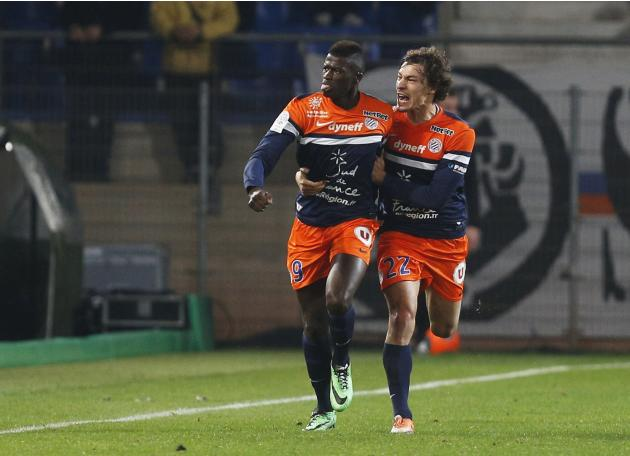 Niang of Montpellier celebrates after goal against Monaco with Stambouli during French League soccer match in Montpellier