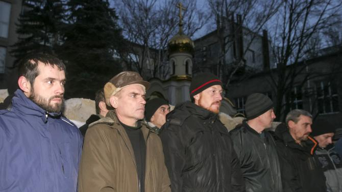 Ukrainian prisoners of war get ready to be transported for exchange for members of pro-Russian separatists in Donetsk