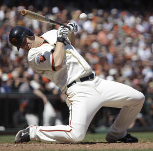San Francisco Giants' Matt Cain is brushed back by a pitch thrown by Arizona Diamondbacks' Daniel Hudson while attempting to bunt during the seventh inning of a baseball game Thursday, May 12, 2011, in San Francisco. (AP Photo/Ben Margot)