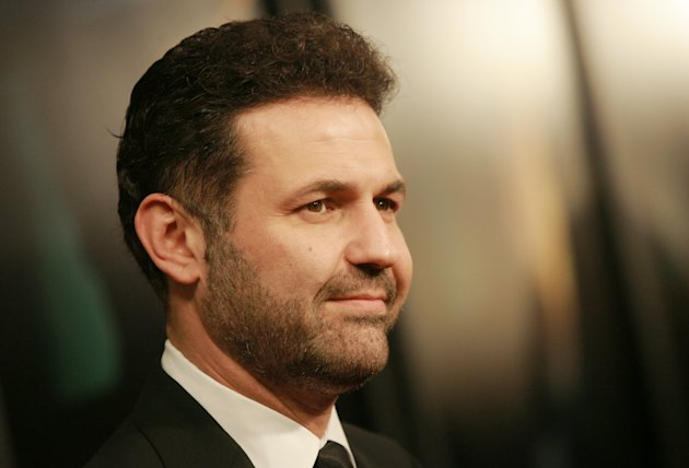 "FILE - This Dec. 10, 2007 file photo shows author Khaled Hosseini at the ""There Will Be Blood"" premiere at the Ziegfeld Theatre in New York. Hosseini's next novel will be a journey across time and space. The author of the million-sellers ""The Kite Runner"" and ""A Thousand Splendid Suns"" has finished his third book, ""And the Mountains Echoed."" Riverhead Books, an imprint of Penguin Group (USA), announced Monday, Oct. 29, 2012, that the new book comes out May 21. (AP Photo/Evan Agostini, dile)"