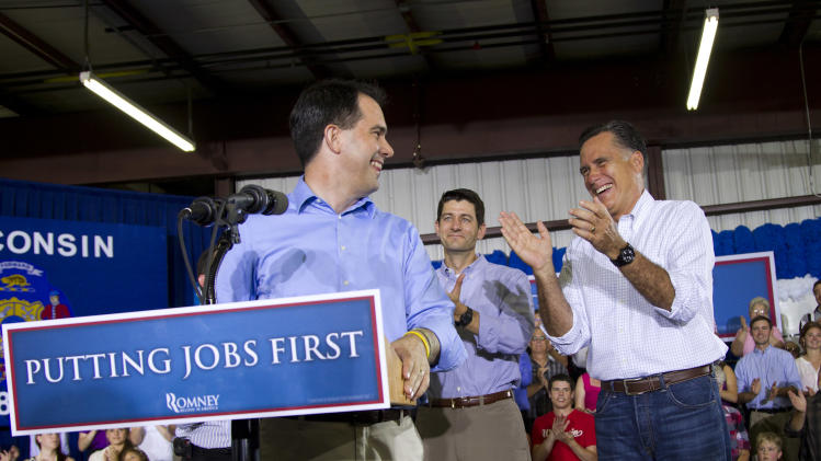 Republican presidential candidate, former Massachusetts Gov. Mitt Romney, right, is introduced by Gov. Scott Walker, R-Wis., left, as Rep. Paul Ryan, R- Wis. looks on during a campaign stop at Monterey Mills on Monday, June 18, 2012 in Janesville, Wis.  (AP Photo/Evan Vucci)