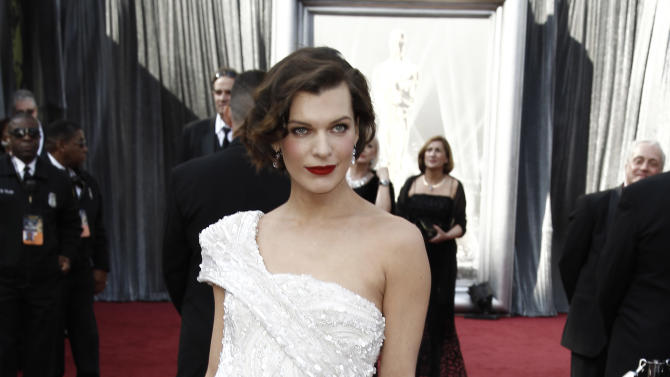 Milla Jovovich arrives before the 84th Academy Awards on Sunday, Feb. 26, 2012, in the Hollywood section of Los Angeles. (AP Photo/Matt Sayles)