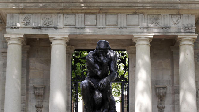 "Auguste Rodin's ""The Thinker"" is displayed at the entrance to the grounds of the Rodin Museum on Wednesday, May 16, 2012, in Philadelphia. After a three-year renovation, the museum is scheduled to reopen to the public on July 13. (AP Photo/Alex Brandon)"