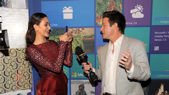 IMAGE DISTRIBUTED FOR MICROSOFT - Emmy Rossum, left, and Billy Bush are seen with Windows Phone  8X by HTC at Microsoft All Access Holiday Party on Thursday, Dec. 6, 2012, in Venice, Calif. (Photo by Chris Pizzello/Invision for Microsoft/AP Images)