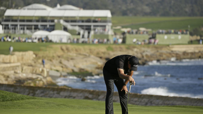 Phil Mickelson reacts after missing a birdie putt on the 18th green of the Pebble Beach Golf Links during the final round of the AT&T Pebble Beach National Pro-Am golf tournament Sunday, Feb. 14, 2016, in Pebble Beach, Calif. Vaughn Taylor won the tournament by one stroke over Mickelson. (AP Photo/Eric Risberg)