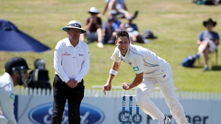 Trent Boult of New Zealand bowls on day one of his side's third Test match against the West Indies at the Seddon Park in Hamilton on December 19, 2013