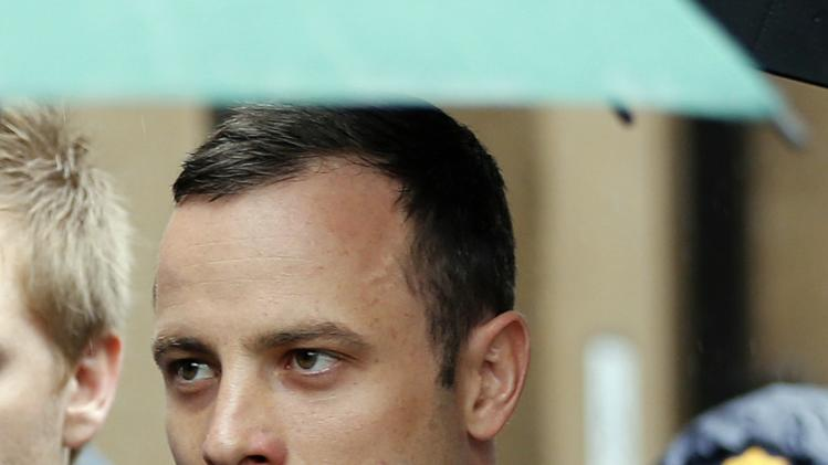Olympic and Paralympic track star Oscar Pistorius arrives at court ahead of the fifth day of his trial for the murder of his girlfriend Reeva Steenkamp at the North Gauteng High Court in Pretoria