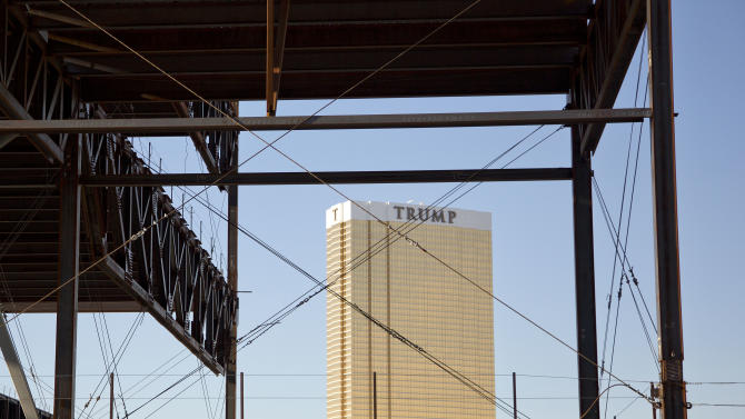 The Trump Tower is seen framed in the skeleton of the stalled Echelon construction site, Saturday, March 2, 2013, in Las Vegas.  The Genting Group announced the purchase of the nearly 90 acres on the Las Vegas Strip of the Boyd Gaming Corp.'s stalled project. The Asian conglomerate has plans for a phased, multi-billion dollar development that would include 3,500 hotel rooms, a convention center and gambling, dining and retail. (AP Photo/Julie Jacobson)