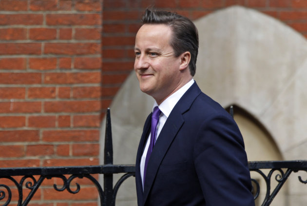 British Prime Minister David Cameron arrives to give evidence at the Leveson inquiry at the Royal Courts of Justice in central London, Thursday, June 14, 2012. The judge-led inquiry was set up following revelations of phone hacking at Murdoch's News of the World tabloid. The scandal has shaken the British establishment and raised questions about whether top politicians helped shield Murdoch from scrutiny. (AP Photo/Lefteris Pitarakis)