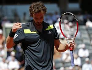 Ernests Gulbis of Latvia reacts during his men's semi-final match against Novak Djokovic of Serbia at the French Open tennis tournament at the Roland Garros stadium in Paris