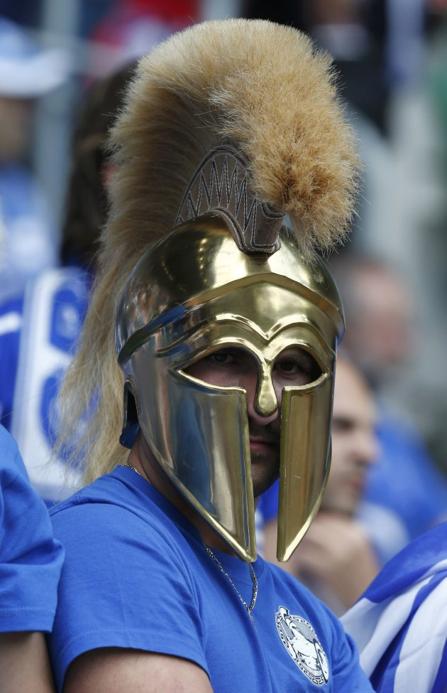 Greece soccer fan wearing Spartan helmet waits for start of Euro 2012 soccer match against Czech Republic in Wroclaw