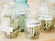 glass jars of change and bills