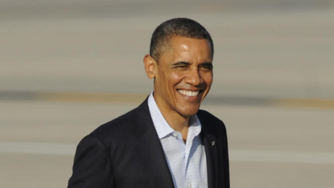 President Barack Obama smiles after exiting Marine One at Chicago O'Hare International Airport in Chicago, June 17, 2012. (AP Photo/Paul Beaty)
