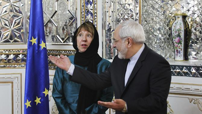 Iranian Foreign Minister Mohammad Javad Zarif, right, welcomes European Union's foreign policy chief Catherine Ashton for their meeting, in Tehran, Iran, Sunday, March 9, 2014. Ashton is saying there is no guarantee for a successful final nuclear deal with Iran. (AP Photo/Vahid Salemi)
