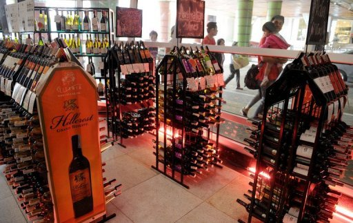 &lt;p&gt;Pedestrians walk past a stall selling alcoholic beverages at a mall in Manila on January 1, 2013. A &quot;sin tax&quot; on cigarettes and alcohol dampened the New Year party spirit when it was introduced in the Philippines on January 1, as part of a government bid to boost finances.&lt;/p&gt;