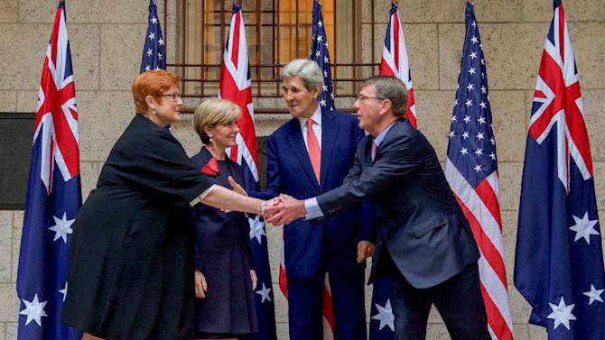 L-R: Australian Defense Minister Marise Payne, Australian Foreign Minister Julie Bishop, US Secretary of State John Kerry and US Defense Secretary Ashton Carter pose prior to a meeting on October 13, 2015 in Boston