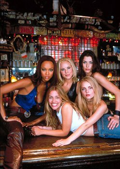 The hottest night spot in New York is a bar called Coyote Ugly, which features a team of sexy enterprising young women, including (clockwise, center, left to right) Lil ( Maria Bello ), Rachel ( Bridg