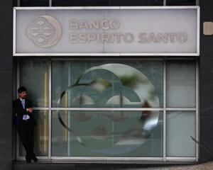 A man passes by an office of Portuguese bank Banco Espirito Santo (BES) in downtown Lisbon