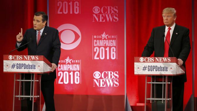 Republican U.S. presidential candidate Cruz speaks as Trump listens at the Republican U.S. presidential candidates debate sponsored by CBS News and the Republican National Committee in Greenville