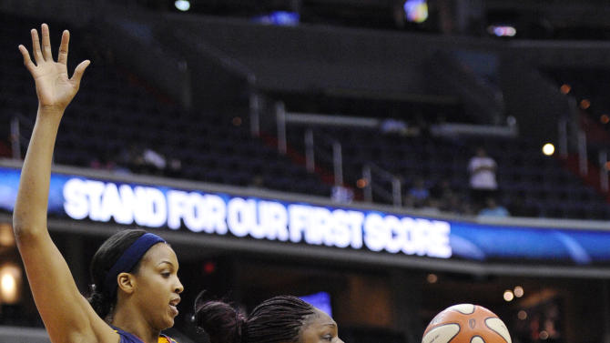 Indiana Fever's Tammy Sutton-Brown (8) and Washington Mystics' Nicky Anosike (21) battle for the ball during the first half of a WNBA basketball game, Friday, July 29, 2011, in Washington. (AP Photo/Nick Wass)