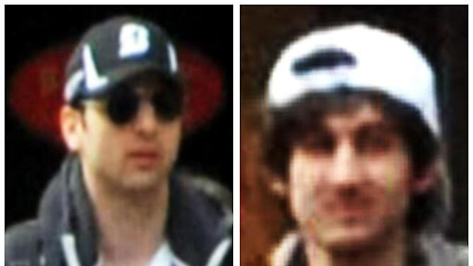 This combo of photos released by the Federal Bureau of Investigation early Friday April 19, 2013, shows what the FBI is calling suspects number 1, left, and suspect number 2, right, walking through the crowd in Boston on Monday, April 15, 2013, before the explosions at the Boston Marathon. (AP Photo/FBI)
