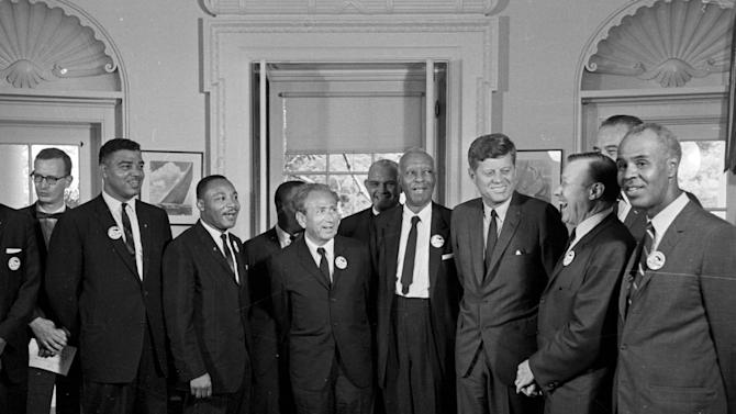 FILE - In this Aug. 28, 1963 file photo, President Kennedy stands with a group of leaders of the March on Washington at the White House in Washington. Immediately after the march, they discussed civil rights legislation that was finally inching through Congress. The leaders pressed Kennedy to strengthen the legislation; the president listed many obstacles. Some believe Kennedy preferred to wait until after the 1964 election to push the issue. Yet in his public speeches, he spoke more and more about justice for all. From second left are Whitney Young, National Urban League; Dr. Martin Luther King, Christian Leadership Conference; John Lewis, Student Non-violent Coordinating Committee, partially obscured; Rabbi Joachim Prinz, American Jewish Congress; Dr. Eugene P. Donnaly, National Council of Churches; A. Philip Randolph, AFL-CIO vice president; Kennedy; Walter Reuther, United Auto Workers; Vice President Lyndon B. Johnson, partially obscured, and Roy Wilkins, NAACP. (AP Photo/File)